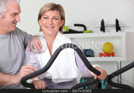 senior couple training in the gym stock photo, senior couple training in the gym by photography33