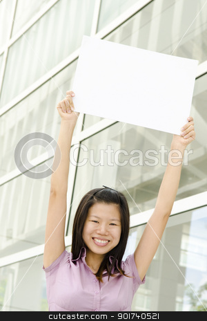 Blank paper for advertisement stock photo, Beautiful businesswoman with blank paper for advertisement by szefei
