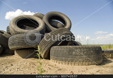 Heap of the old worn out automobile tyre covers. stock photo, A lot of Wheel Tires dumped in a landfill. by Yury Ponomarev