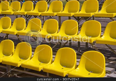 Yellow seats. stock photo, Lines of yellow seats. by Yury Ponomarev