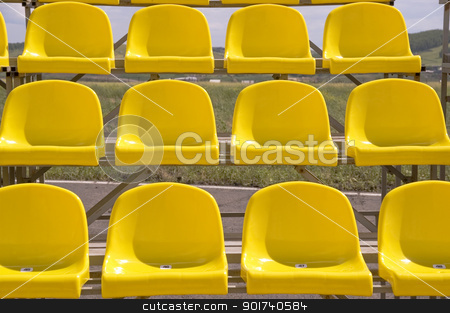 Yellow seats. stock photo, Lines of yellow seats. by Yury Ponomarev