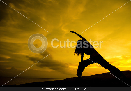 Yoga in nature stock photo, Silhouette of Woman Practicing Yoga (Warrior Pose) by szefei