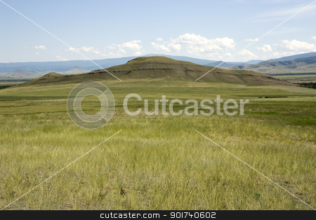 Mountain valley. stock photo, Field of a green grass on a background of mountains. by Yury Ponomarev