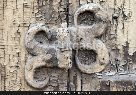 Old metal details. stock photo, Old metal details on an old board. by Yury Ponomarev