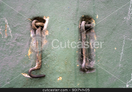 Old wall. stock photo, Two old metal hooks. by Yury Ponomarev