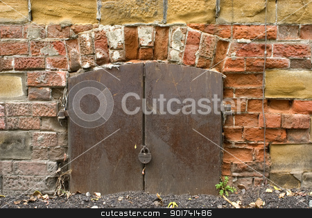 Old wall from a red brick. stock photo, Old brick wall, metal door with the lock. by Yury Ponomarev