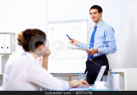Young businessman in the office stock photo, Young and successful businessman in the office by Sergey Nivens