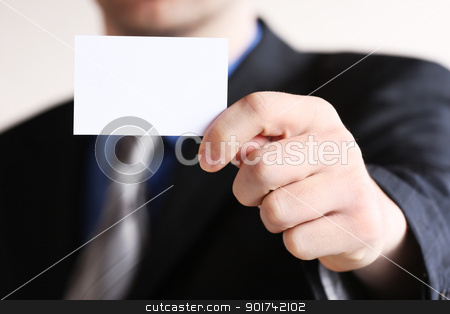 Young businessman offering businesscard  stock photo, Businessman holding his business card in hand by Viktor Thaut