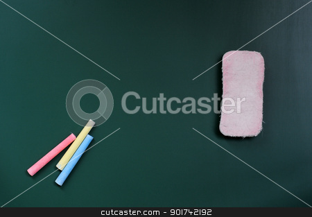 Blank blackboard with eraser and chalk stock photo, Blank blackboard for copy space with eraser and chalk by John Young