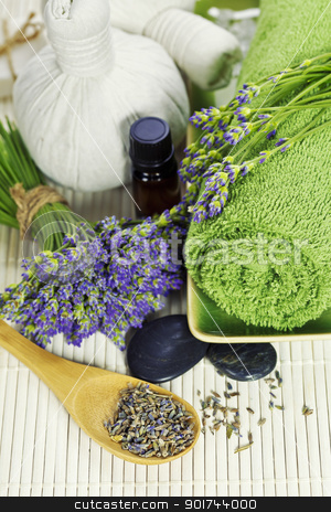 lavender spa stock photo, lavender spa (fresh lavender flowers,  essential oil, towel,  Herbal massage balls, zen stones) by klenova