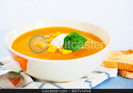 Pumpkin soup with cream in a bowl with painted flower and toast  stock photo, Pumpkin soup with cream in a bowl with painted flower and toast as a garnish. by p.studio66