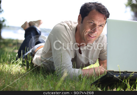 Man working on the grass stock photo, Man working on the grass by photography33