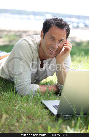 Man smiling working on the grass stock photo, Man smiling working on the grass by photography33
