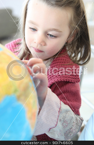 Little girl looking at globe stock photo, Little girl looking at globe by photography33
