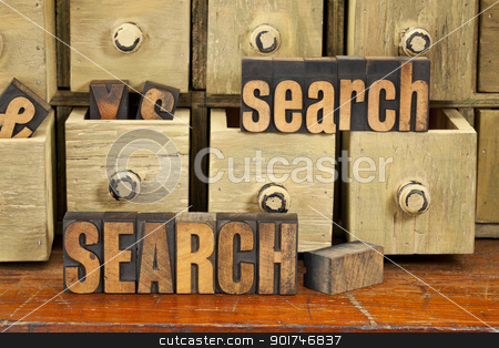 search word concept in wood type stock photo, search word or SEO concept  - vintage letterpress wood type with primitive apothecary drawer cabinet by Marek Uliasz