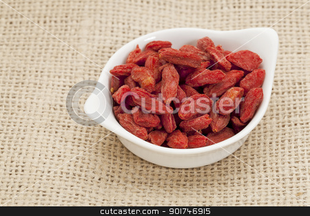 organic goji berries stock photo, organic goji berries (wolfberry) in a small ceramic bowl - HImalayan superfood by Marek Uliasz