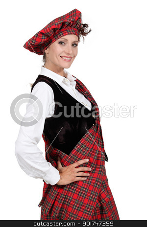 Woman in a traditional tartan outfit stock photo, Woman in a traditional tartan outfit by photography33