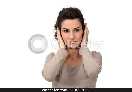 Woman covering her ears stock photo, Woman covering her ears by photography33