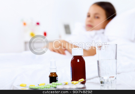 Girl with cold at home stock photo, Little girl with illness at bed at home by Sergey Nivens