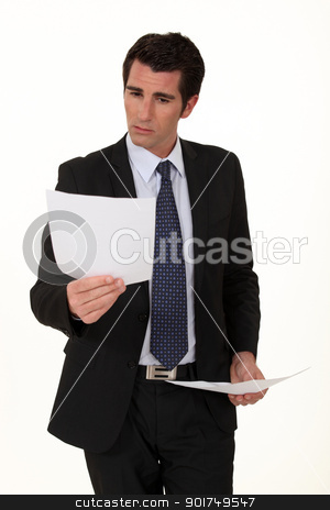 Businessman reading document stock photo, Businessman reading document by photography33