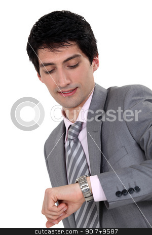 Businessman looking at the time stock photo, Businessman looking at the time by photography33