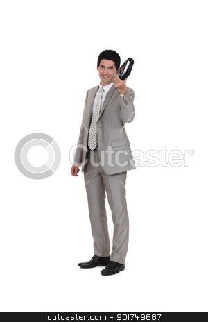 Businessman holding an agenda stock photo, Businessman holding an agenda by photography33