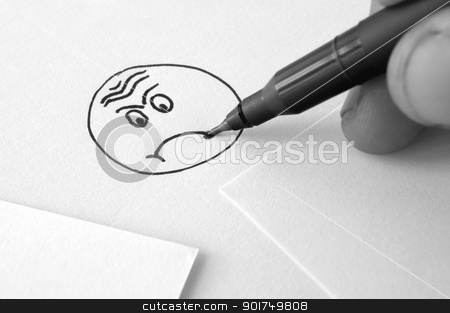 sad face drawing  stock photo, hand and pen drawing a sad face on paper by Ioan Panaite