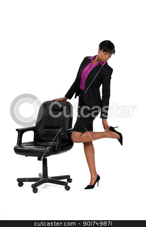 Businesswoman checking her heels stock photo, Businesswoman checking her heels by photography33