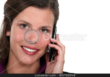 Woman talking on her mobile phone stock photo, Woman talking on her mobile phone by photography33