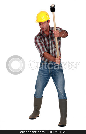 craftsman striking with a huge hammer stock photo, craftsman striking with a huge hammer by photography33