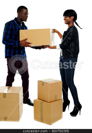 Couple moving empty cartons stock photo, An isolated shot of couple moving empty cartons to new place by Ishay Botbol