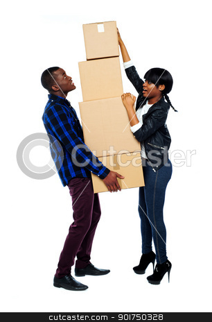 A young couple holds boxes in studio stock photo, A young couple holds boxes in studio isolated over white background by Ishay Botbol