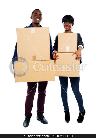 Attractive african couple holding cardboard boxes stock photo, Smiling young couple holding cardboard boxes. Moving to a new place by Ishay Botbol