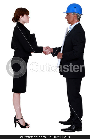 An architect and a businesswoman shaking hands. stock photo, An architect and a businesswoman shaking hands. by photography33