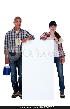 Decorators with a board left blank for your message stock photo, Decorators with a board left blank for your message by photography33