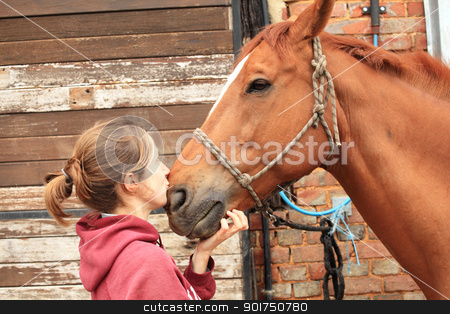 tender moment between a woman and her horse stock photo, tender moment between a woman and her horse by Chretien