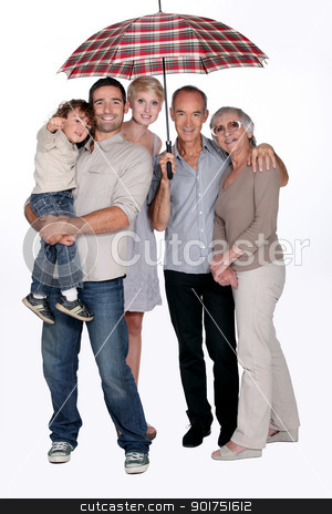 Family protected under an umbrella, studio shot stock photo, Family protected under an umbrella, studio shot by photography33