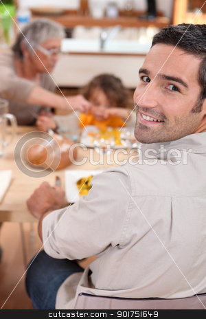 Family having meal in kitchen stock photo, Family having meal in kitchen by photography33