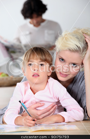 Mother helping daughter with homework stock photo, Mother helping daughter with homework by photography33