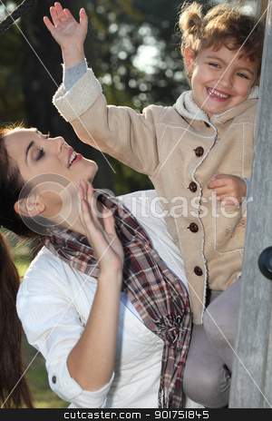 Mother and daughter climbing a tree stock photo, Mother and daughter climbing a tree by photography33
