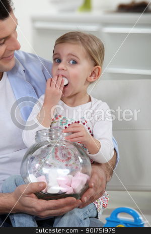 father watching his daughter eating candies stock photo, father watching his daughter eating candies by photography33