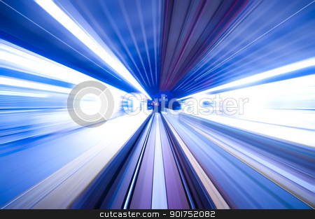 Fast train passing by train station at dusk.  stock photo, Fast train passing by train station at dusk. Long exposure. Focus on the road. by szefei