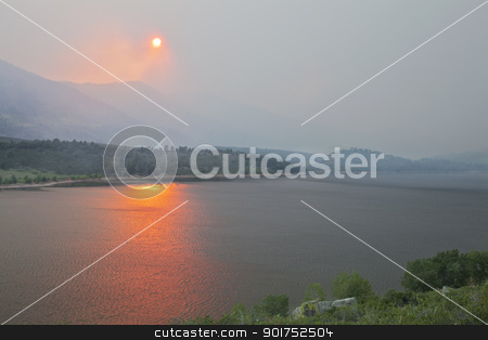 wildfire smoke in Colorado stock photo, heavy smoke from High Park wildfire obscuring the sun and sky over Horsetooth Reservoir and foothills near Fort Collins, Colorado, June 10, 2012 by Marek Uliasz