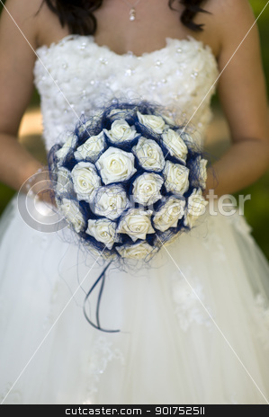bride with fake flowers stock photo, bride holding imitation flower bouquet by Lee Avison
