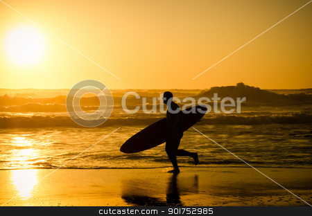 Surfer running stock photo, Surfer running on the beach with the waves at sunset in Portugal. by Homydesign