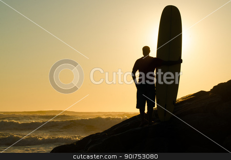 Long boarder watching the waves stock photo, A long boarder watching the waves at sunset in Portugal. by Homydesign