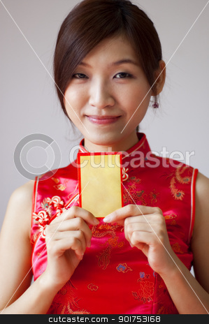 Happy Chinese New Year. stock photo, Oriental girl in cheongsam wear holding a Chinese red packet wishing you happy Chinese New Year. by szefei
