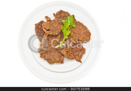 Chicken cutlet stock photo, Chicken cutlet served on a plate and decorated with parsley leaf by derejeb