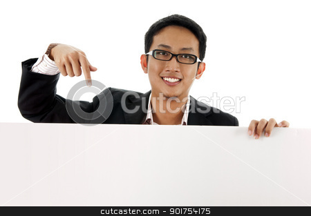 Blank paper for advertisment. stock photo, Executive male pointing on a blank space. by szefei