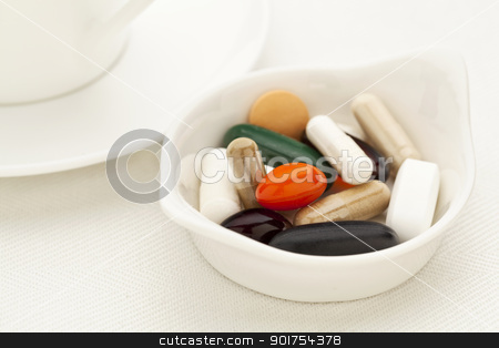 vitamin and supplement pills stock photo, bowl of vitamin, supplement  and medicine pills - breakfast concept - shallow depth of field by Marek Uliasz